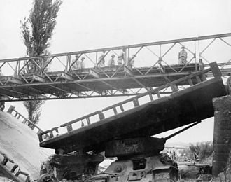 Military engineering - A Bailey bridge being deployed in the Korean War to replace a bridge destroyed in combat.