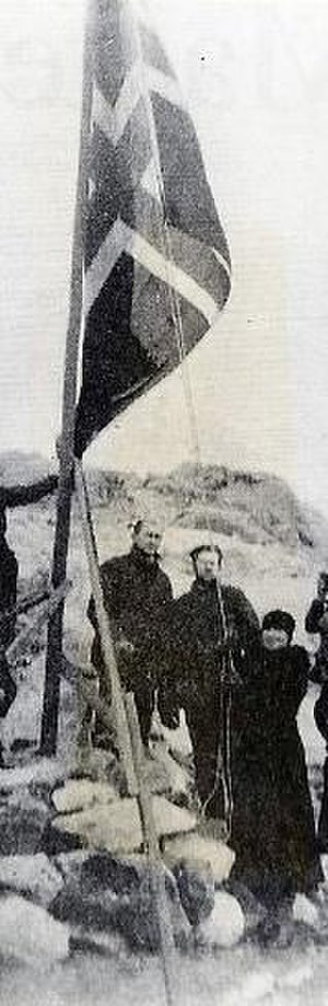 Caroline Mikkelsen - Caroline Mikkelsen raising the flag of Norway at a cairn on  the Antarctic Tryne Islands, 1935.