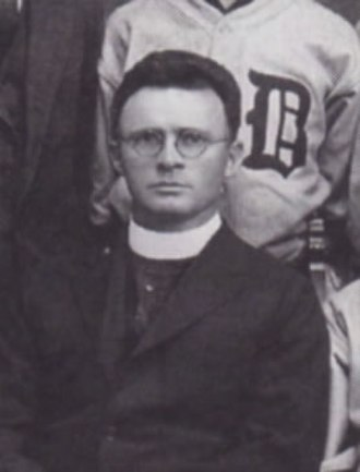 Eugene McGuigan - Father McGuigan in the 1922 men's baseball team photo