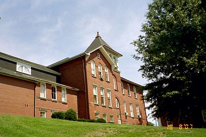 Johnson Hall, Muskingum's second building, sits ontop a hill near the main campus entrance