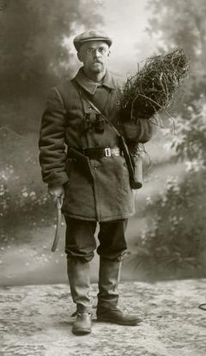 Niels Ebbesen Hansen - A 1908 portrait of Hansen during his third plant exploration to Russia. He wears his field exploration gear and holds a bundle of alfalfa. Photo courtesy South Dakota Agricultural Heritage Museum.