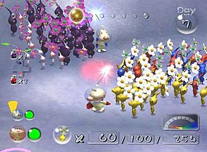 Pikmin 2 - The player simultaneously controls both Olimar (bottom) and Louie (top), who can each lead separate Pikmin groups. The varying Pikmin colors indicate their immunity to environmental hazards.