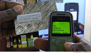 Sproxil - Package with Sproxil label and phone showing SMS reply