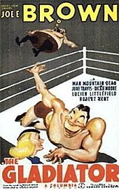 Cartoon figure of a muscular man wearing boxing trunks, lying on the floor of a boxing ring and flinging another man over the ropes.