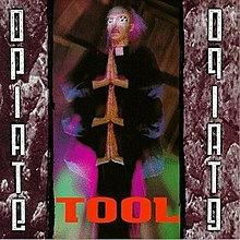 Cover art for Opiate, featuring a priest with six arms and hands, with the hands pressed together
