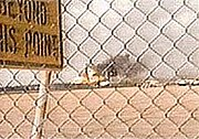 The plane landed askew, causing the explosion and fire seen in this still from an amateur video.