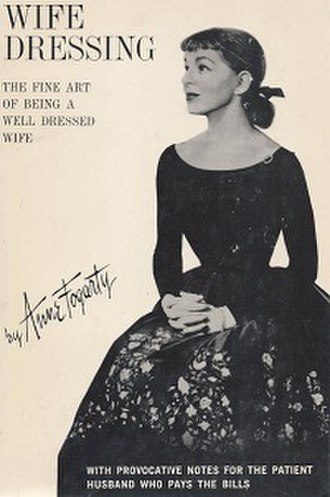 Anne Fogarty - Anne Fogarty wearing one of her own dresses, on the front cover of the first edition of her book Wife Dressing (1959)