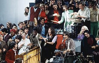 "Hey Jude - The Beatles performing in the ""Hey Jude"" promotional film, surrounded by members of the studio audience"