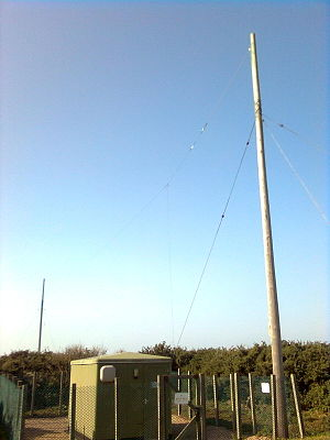 Non-directional beacon - NDB transmitter at 49° 12.35' N, 2° 13.20' W. Callsign JW – 'Jersey West'. 329.0 kHz.