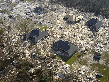 Many houses were leveled, gutted or flooded in Gulfport, Mississippi by the 28-foot storm surge of Hurricane Katrina (click: closeup view of cars/boats/appliances)