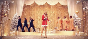 Oh Santa! - Carey portrayed as a performer on the fictional Christmas television show in the music video.