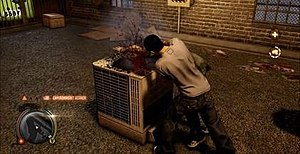 Sleeping Dogs (video game) - Shen performs an environmental kill against an enemy. The health meter, mini-map and status buffs are shown on the heads-up display.