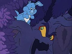 A blue rabbit stands upon one of the branches of a possessed tree, looking at its menacing face.