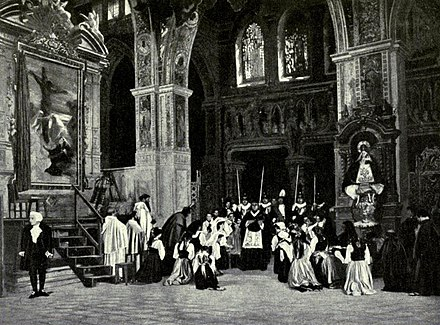 The Te Deum scene which concludes act 1; Scarpia stands at left. Photograph of a pre-1914 production at the old Metropolitan Opera House, New York Tosca Te Deum Victrola Book of Opera.jpg