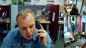 """Cold Comfort (Inside No. 9) - Most of """"Cold Comfort"""" is made up of the streams for four fixed cameras in the style of a CCTV feed. Here, Andy talks on the phone to """"Chloe"""" (main camera and bottom right) while George sits in his office (top right) and Liz leaves the workspace (centre right). The date is visible in the bottom left."""