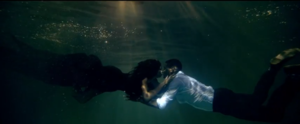 Dive (Usher song) - Usher and Chanel Iman kissing underwater in the videos closing scene.