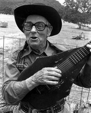 Jimmy Driftwood - Driftwood posing with his unusual guitar