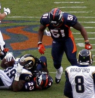Joe Mays (American football) - Mays (51) looks on as teammates tackle Steven Jackson on November 28, 2010.
