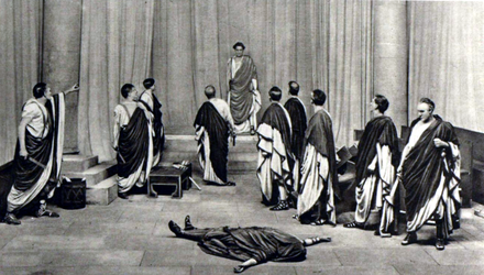 stage scene with actors in Roman togas