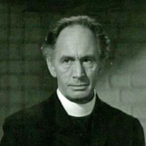 Leonard Mudie - Mudie as the priest in Rage in Heaven (1941)