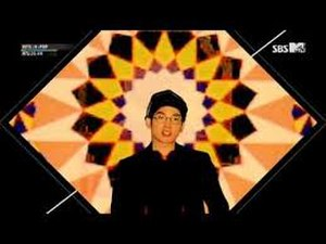 "SBS MTV - Screenshot of SBS MTV with 2013 graphics, taken from ""MTV Hits: K-POP"". At the upper left corner, the current program's title and SBS MTV's website can be seen. SBS MTV's logo is in the upper right corner."