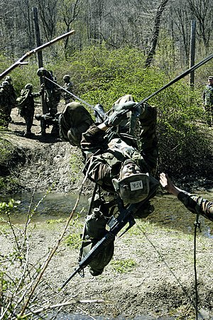 Sandhurst Competition - A U.S. Air Force Academy Cadet crosses one-rope bridge in 2004.