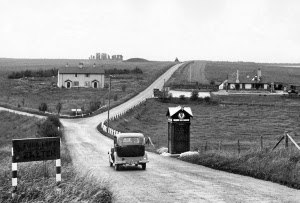 "A303 road - The A303 near Stonehenge c.1930. Sign reads ""Fork left for Exeter"". The houses and AA phone box have since been demolished."