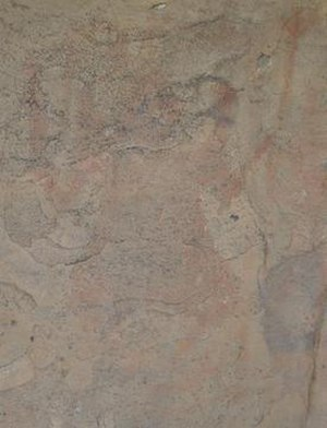 "Bhimbetka rock shelters - An eroded painting in the Bhimbetka caves shows ""Nataraj"" dancing and holding a trishula or trident"