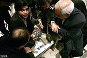 Seen here in this ISNA footage is Gholam Reza Aghazadeh and AEOI officials with a sample of Yellowcake during a public announcement on the April 11, 2006, in Mashad that Iran had managed to successfully complete the fuel cycle by itself.
