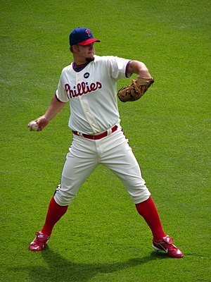 Phillies pitcher Joe Blanton warming up before...