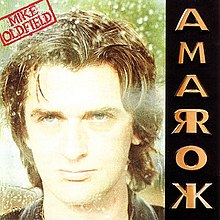 The Amarok album cover. It shows a photograph of Oldfield's face along with a red stamp containing his name at the top left. On the right side arranged vertically is the name Amarok in gold coloured capital letters; the letters A, M and O appear normally, but R and K are mirrored about the vertical stroke of the letter.