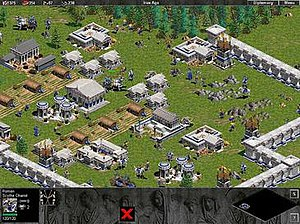 Age of Empires: The Rise of Rome - Screen capture featuring the new architectural design which is used by the additional civilizations encompassed in the expansion pack. The scythe chariot, one of new units, can also be seen.