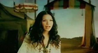"Ai o Komete Hanataba o - Superfly in the music video for ""Ai o Komete Hanataba o""."