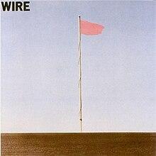 Обложки альбома для группы Wire.  На обложке фотография показывает один флагшток с розовым флагом, против голубого неба.