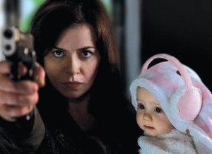 """Gwen Cooper - A promotional image of Gwen defending herself and her daughter in """"The New World"""". The production team chose to feature this scene heavily in advertising the fourth series."""