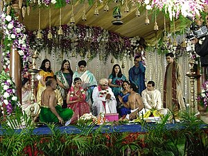 Wedding mandap - Bride and groom as a royal couple under the mandap