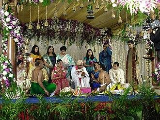 Wedding mandap - Bride and groom as a royal couple under the mandap