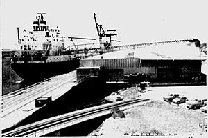 The Daytona Beach Morning Journal found the Atlantic Superior's use of a self-unloading boom remarkable in Brunswik Georgia in 1984.jpg