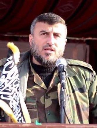Zahran Alloush - Zahran Alloush attending a military parade in eastern Ghouta, 29 April 2015.