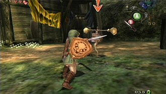 The Legend of Zelda: Twilight Princess - An arrow points at an enemy whom Link is targeting as he prepares to swing his sword (GameCube version).