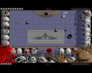 Ballistix - In game shot (Amiga). The black puck has just missed the goal after being deflected by the silver balls.