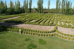 Finca Los Alamos - Borges Memorial Maze garden labyrinth,figure is Camilo Aldao, one of the estancia's current owners