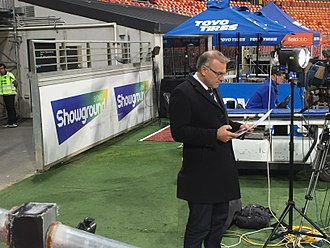 Jim Wilson (sports journalist) - Jim Wilson preparing to file a report for Seven News at Spotless Stadium, Sydney.