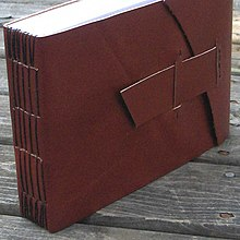 Sample Longstitch binding through a slotted cover