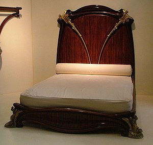 Louis Majorelle - A mahogany bed, known as the Nénuphar bed for its water lily motifs, designed and manufactured by Louis Majorelle around 1902-3, on display at the Musée d'Orsay, Paris.