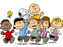 The characters from Peanuts holding aloft Charlie Brown and Snoopy.