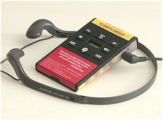 Playaway - Playaway audiobook device. Headphones shown for size reference only.