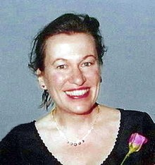 Siobhan Dowd, a female author born in the United Kingdom to Irish parents. This photograph, which shows the author with her hair up while smiling, was taken at her marriage to Geoff Morgan in March 2001, which occurred in Wales.