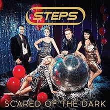 A single cover with two men and three women around a silver, glittering disco ball