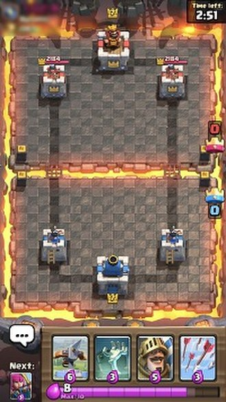 Clash Royale - A screenshot of a 1v1 game displaying the cards with elixir generation at the bottom and all towers still standing